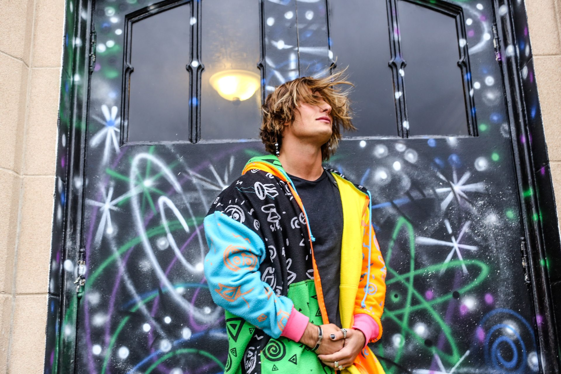 Bryant Wood in front of a Kenny Scharf Mural styled in Mamadoux by Elliott Beach Interview by Brookton Magazine in Denver Colorado